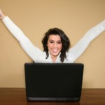 woman arms up laptop