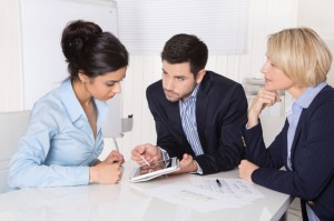 Successful business collaboration - man and two woman.