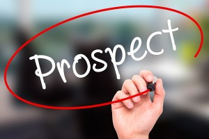 Man Hand writing Prospect with black marker on visual screen.