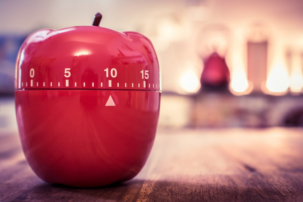 10 Minutes - Red Kitchen Egg Timer In Apple Shape On A Table